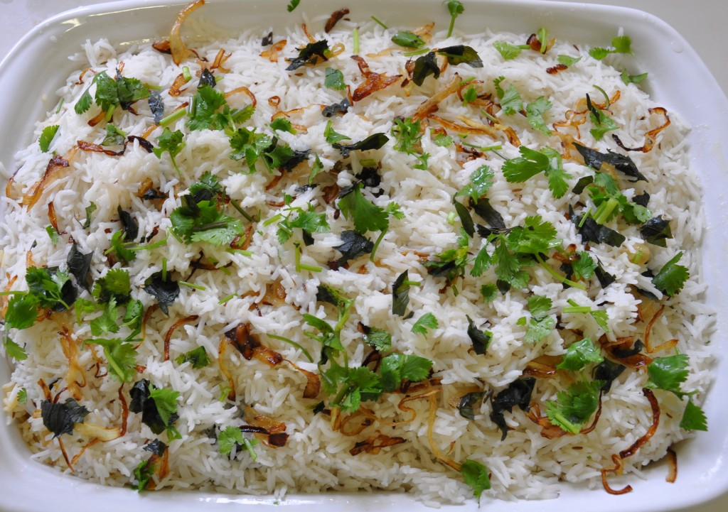 Layered biryani before cooking