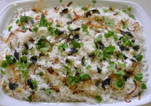 Layered biryani before cooking